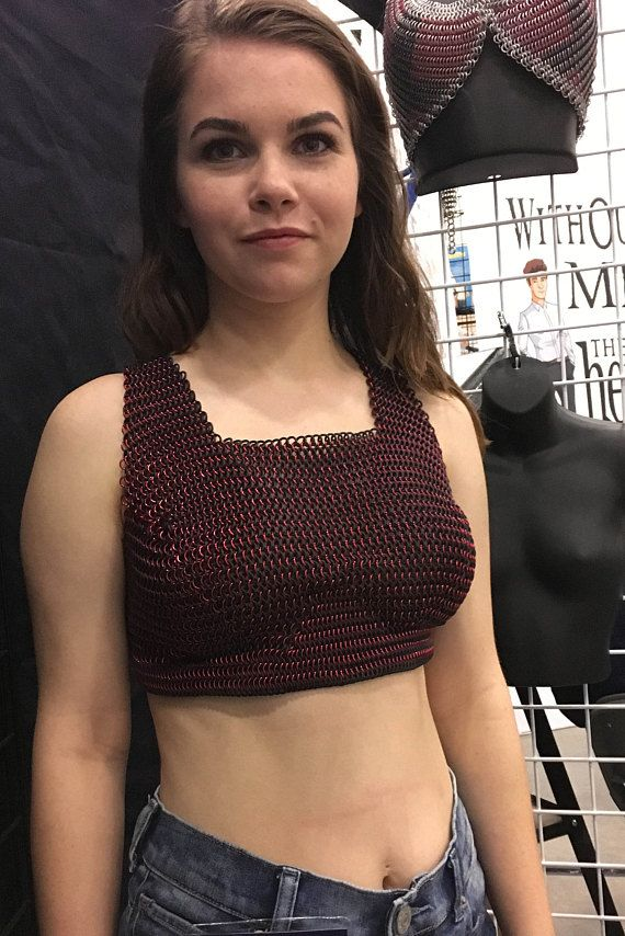 This Chainmalle Halter is made to order and is specifically designed to lift and support. With this top, go bra-less and still have support and look fabulous...or use it as an accessory to your outfit. Made of neoprene (rubber) and anodized aluminum, I designed this Halter to be
