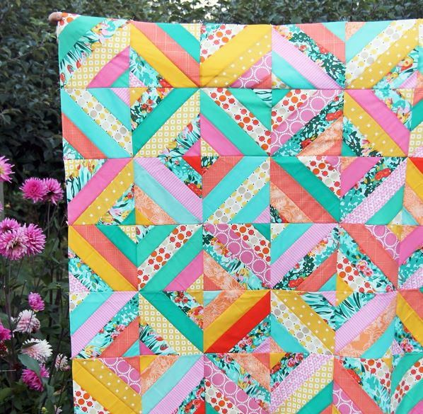 Diagonal Strip Quilt Tutorial | Make a twist on the traditional strip quilt with this easy tutorial!