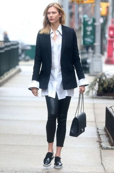 Karlie Kloss wearing Chanel Jumbo Flap Bag, J Brand L8001 Mid-Rise Stretch Leather Pants in Noir, Prada Platform Brogues and Celine Fall 2016 Shirt