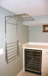 Like this idea for getting stuff off the floor in any room!  ikea laundry room storage - Google Search