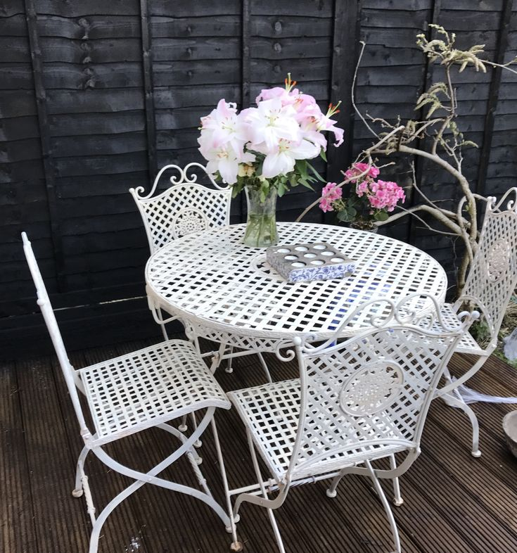 Black fence with Ronseal One Coat Tudor Oak (takes 3 coats ;-)) White french bistro iron patio furniture sprayed with heirloom white spray paint. Decking stained in Ronseal oak.