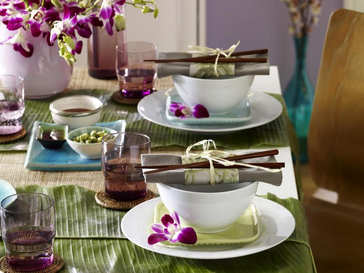 Asian style table setting with banana leaves and orchids  #tablescapes
