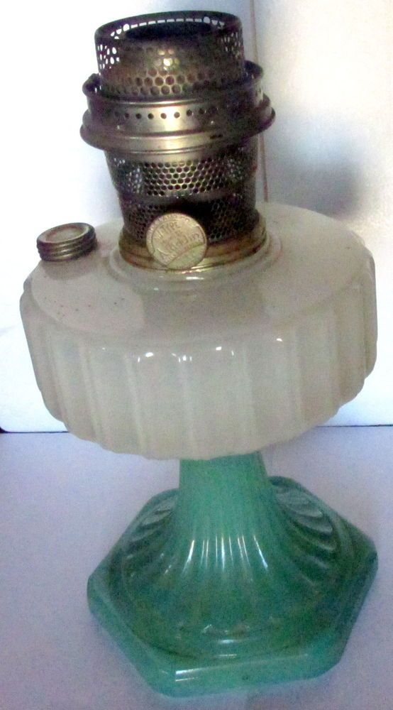 For sale is a late 1930s aladdin lamp model b with a white moonstone top