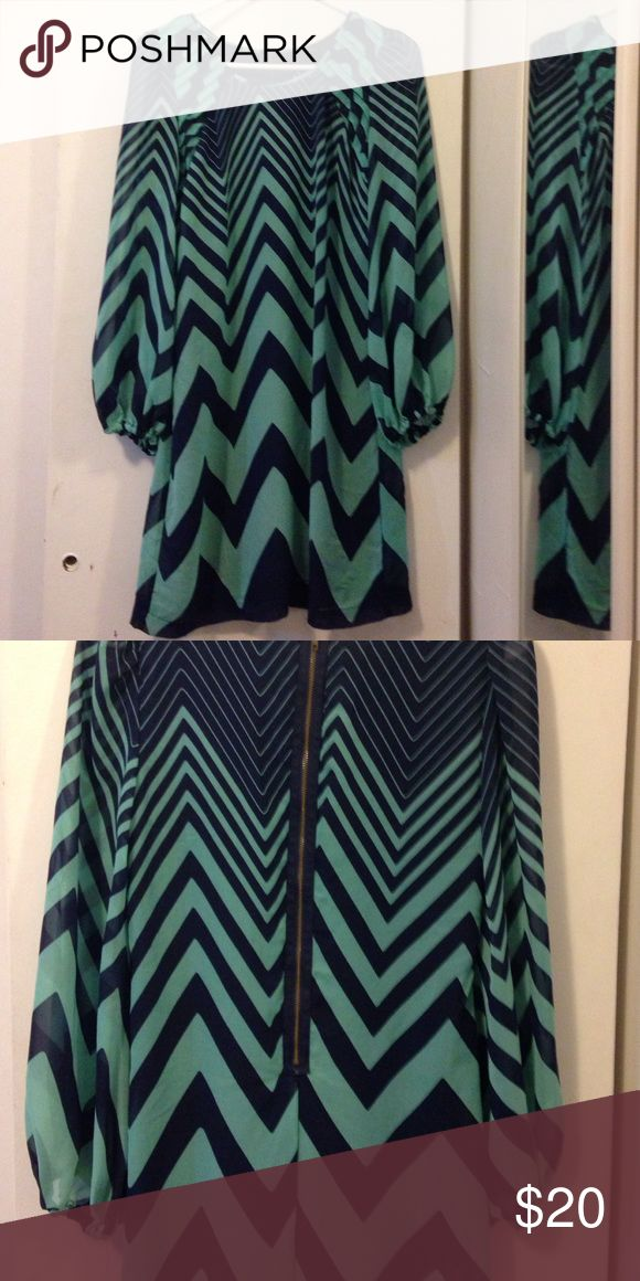 Teal and Navy chevron dress Bought for a vacation and only worn twice! Very cute! Unfortunately doesn't fit anymore. The sleeves are the best part of this dress. From JCPenny. Dresses Mini