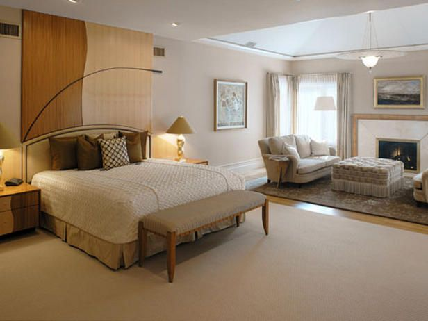 Designer Ann Grasso used this large, custom headboard to define the sleeping area in this master suite.