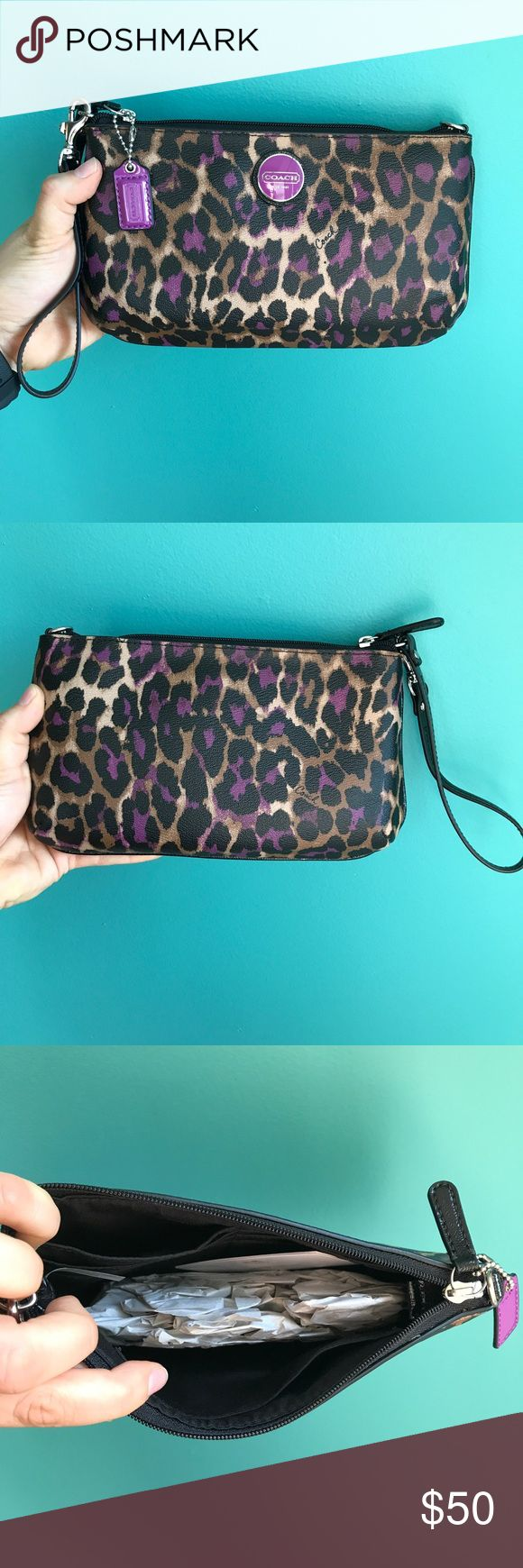 Leopard Coach wristlet Super cute and super girly! Who doesn't love leopard print!? And it's purple! Tags were removed and but I never used it. Pristine condition. It's about 9x5 inches. Silver hardware. Feel free to ask questions. No trades! Coach Bags Clutches & Wristlets