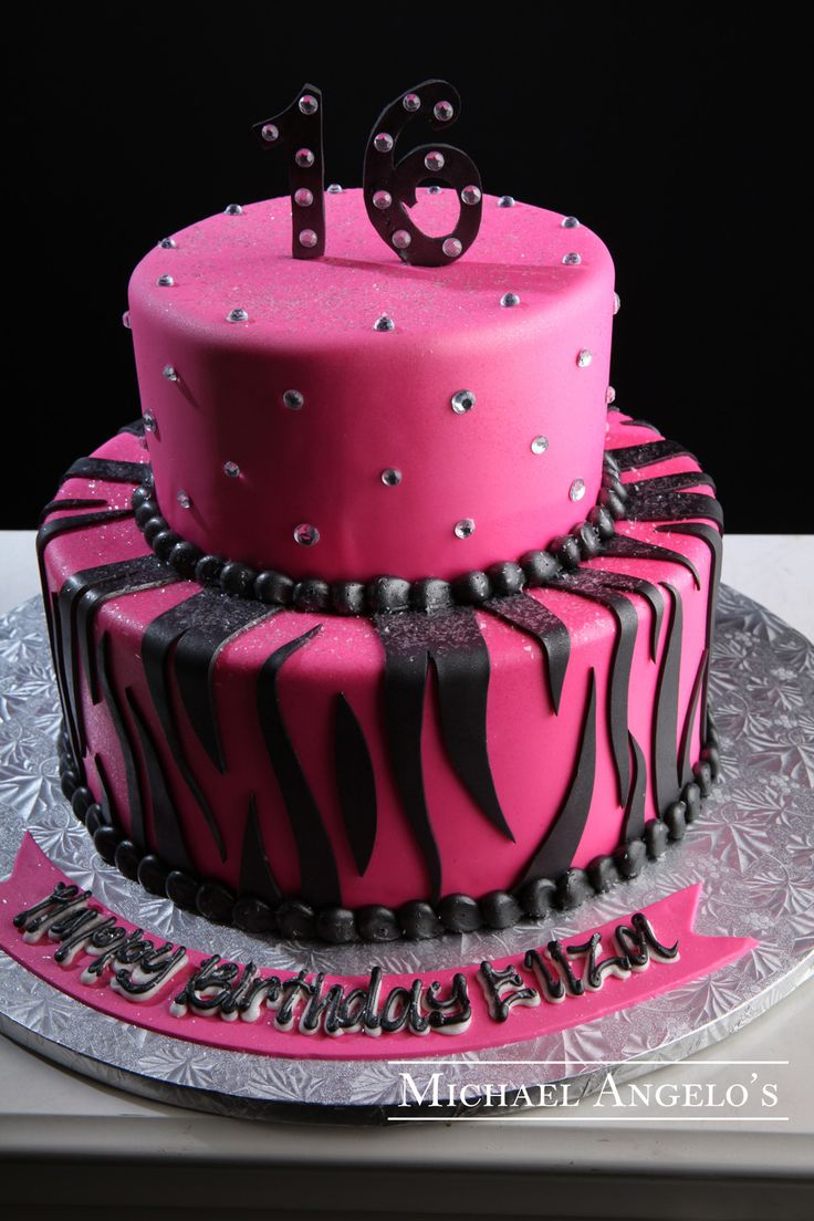 Pink Zebra #68Milestones  This two-tier round design is iced in bright pink fondant. It has gems and animal print design that really give it a festive look. The fondant bow makes a great topper.