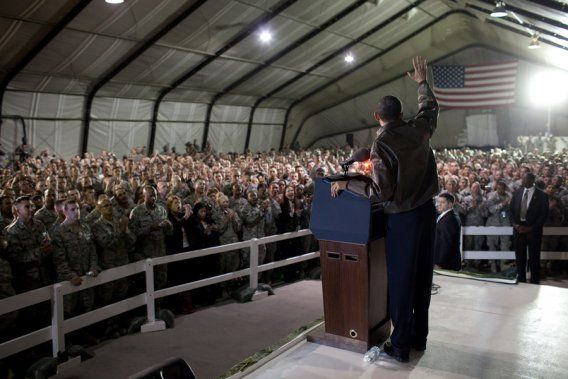 President Barack Obama waves to U.S. troops at Bagram Airfield in Afghanistan, March 28, 2010. It came a few months after he announced a troop surge in the country.