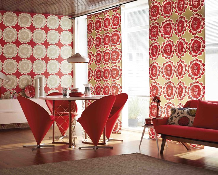 Make your dining table a feature by incorporating some statement chairs. These retro cone chairs almost look too good to sit on! Lotta fabric and wallpaper from Scion's Levande collection.