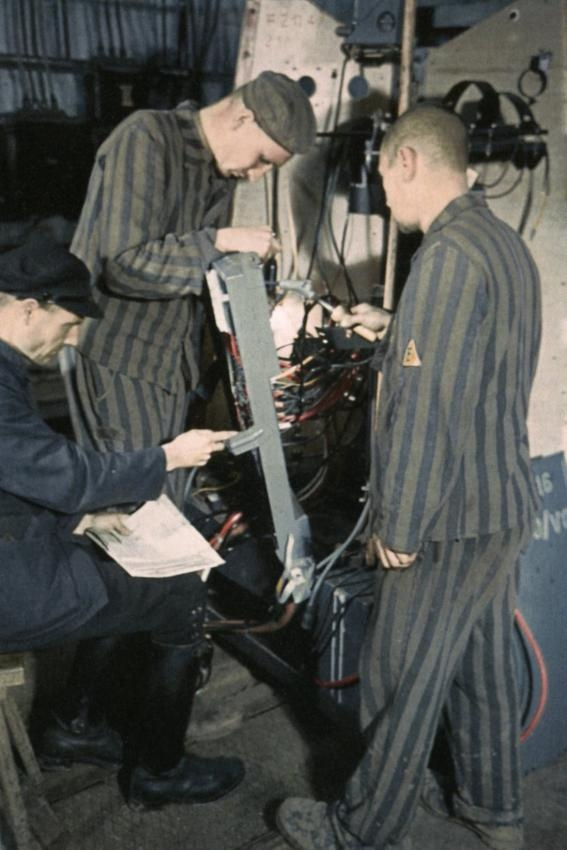 "Concentration camp prisoners at work on a V-2 in ""Mittelwerk"", near Nordhausen in the Harz. This picture was taken between May and July 1944."
