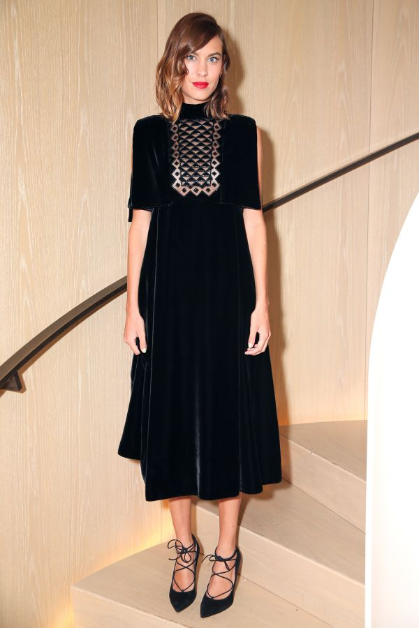 Alexa Chung in a black velvet midi dress and lace up pumps