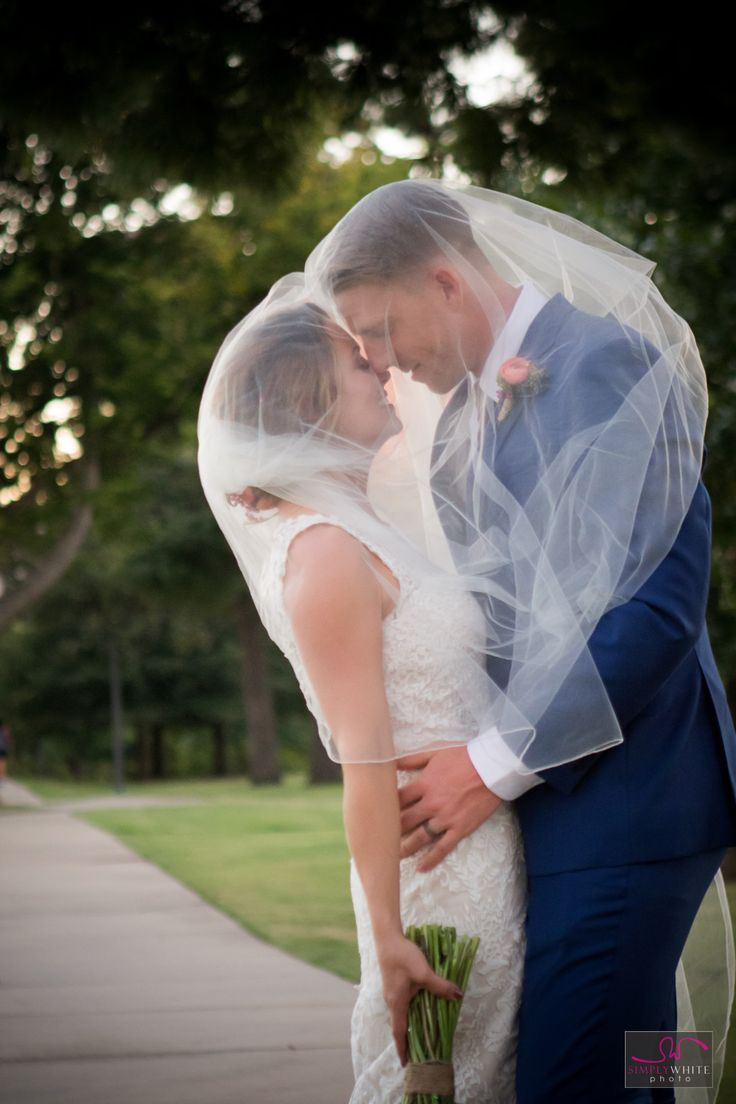 Love love love this romantic veiled shot of the bride and groom! Tulsa Wedding. Centennial Park Wedding Photoshoot