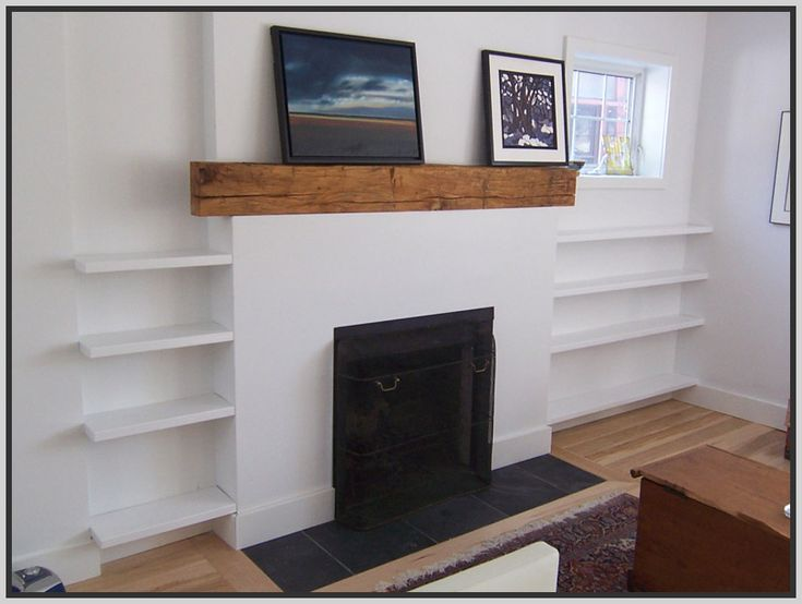 Floating shelves get some of those cabinets off the for Bookshelves next to fireplace