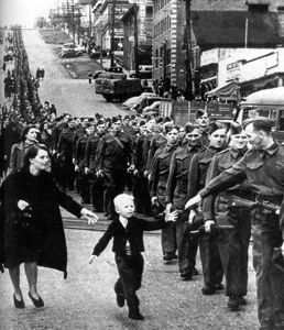 Family saying goodbye to soldier going to war---Canadian Encyclopedia, uses Archives Canada as resource---Shows how families were affected by war. Men had to leave and the families were left to keep things running. Shows how everyone is affected by war.