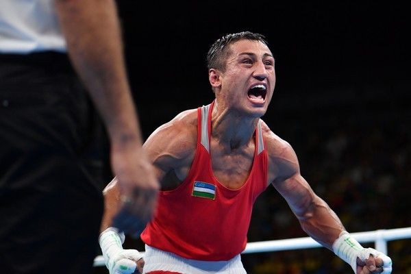 Uzbekistan's Fazliddin Gaibnazarov (red) reacts ater winning  against Azerbaijan's Lorenzo Sotomayor Collazo (blue) during the Men's Light Welter (64kg) Final Bout at the Rio 2016 Olympic Games at the Riocentro - Pavilion 6 in Rio de Janeiro on August 21, 2016.  .Uzbekistan's Fazliddin Gaibnazarov / AFP / Yuri CORTEZ