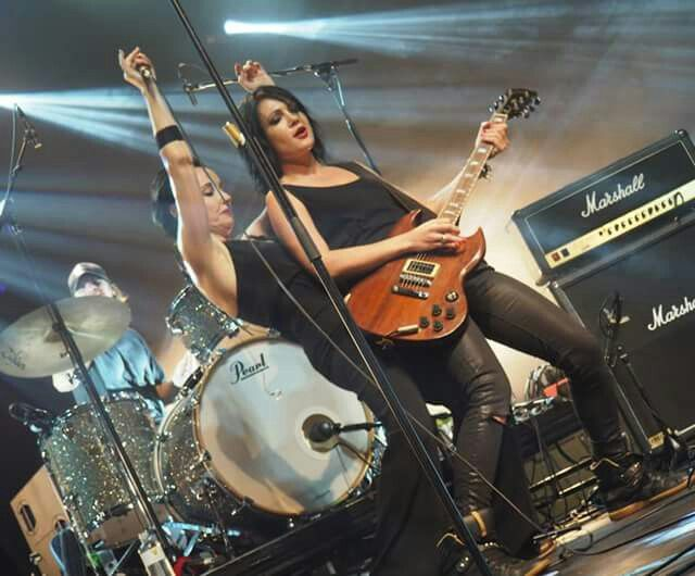 Suze deMarchi of The Baby Animals with Sarah McLeod of The Superjesus performing on the last leg of the She Who Rocks Tour 2015, Hobart, Tasmania. Photograph copyright Brian Higgins for www.ausland181.com