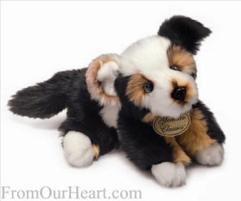 Aussiedoodle from Russ Berrie. A mixture of Australian shepherd and poodle this realistic canine charmer is begging to become someone's new best friend! Each is made of Caress and wears an embossed Yomiko Classics charm. 10.5in (26.7 cm). Surface washable. $12.75