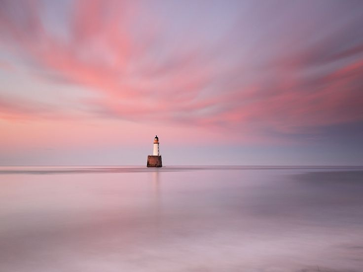 Sunset surrounds Scotland's Rattray Head lighthouse in this National Geographic Photo of the Day.