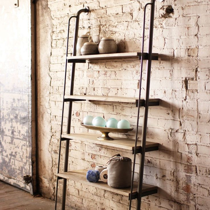 Get impeccable industrial style with these wall-mounted and impressive ladder-style shelves. The double metal bars down the sides provide a sturdy base and a handsome backdrop for your books and mementos.