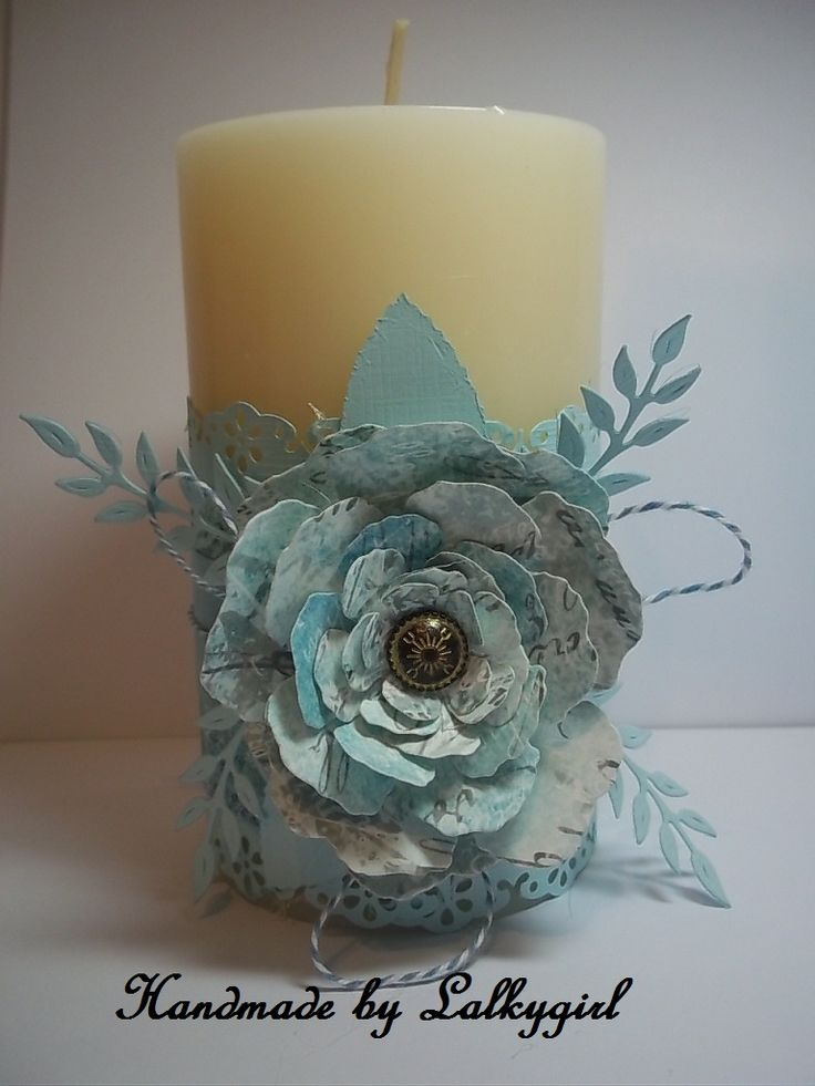 ana altered candle using TH papers and tattered floral die,the brad is from Stampin up