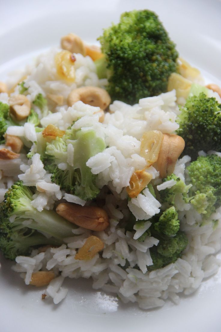 Vegetarian dish. Rice with broccoli, cashew nuts, sesame oil and garlic chips.