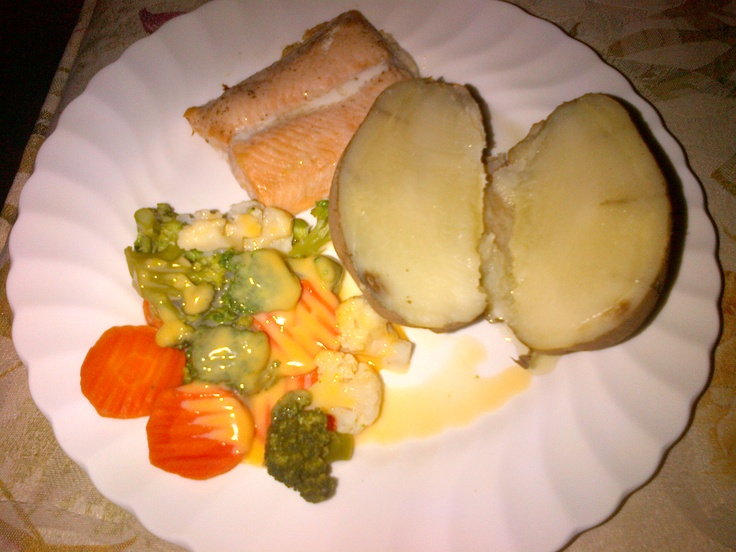 Salmon, Steams Cauliflower, Carrots, and Brocoli with cheese and a Baked Potato
