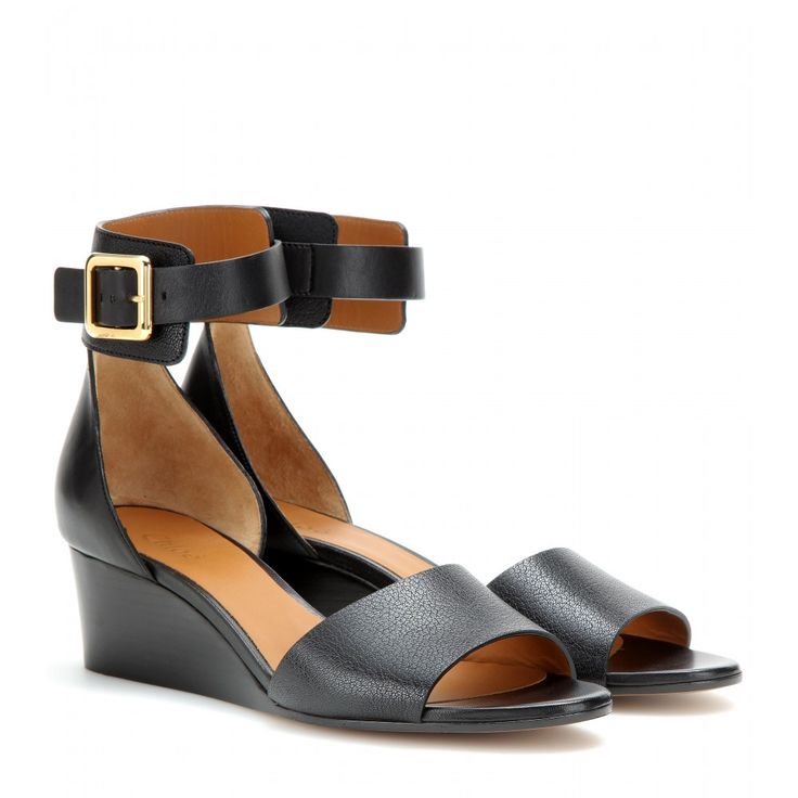 Chloé - Leather wedge sandals - For an elegant alternative to flats, try out the mid-height wedge heel. Chloé's design features a mix of smooth and grainy leather, tied together with an elegant ankle strap. Style with shorter hemlines to make a feature of the gold-tone buckle. seen @ www.mytheresa.com