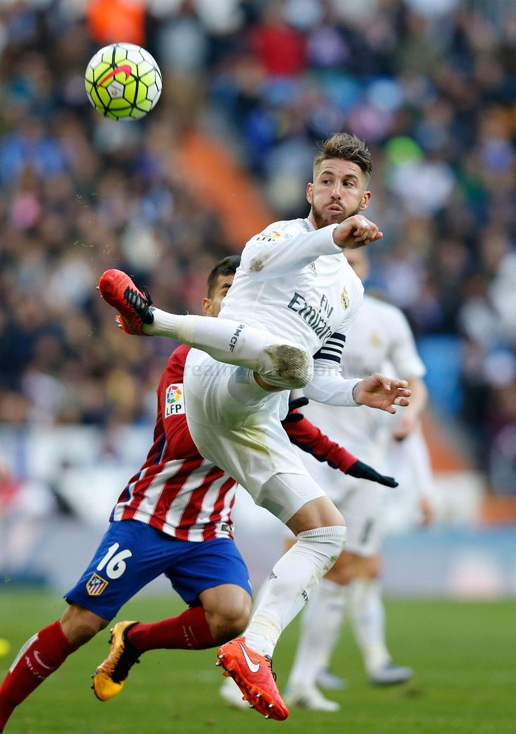 Sergio Ramos of Real Madrid CF competes for the ball with Ángel Correa of Atlético de Madrid during the La Liga match between Real Madrid CF and Club Atlético de Madrid at Estadio Santiago Bernabéu on February 27, 2016 in Madrid, Spain.