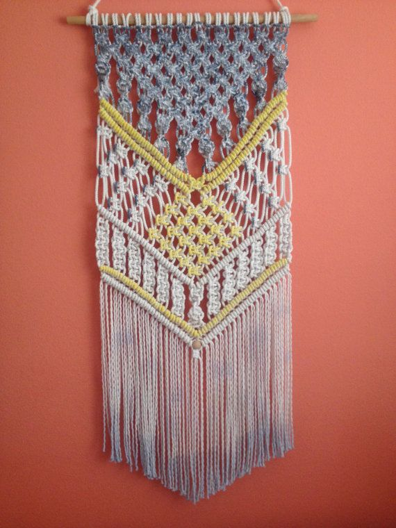 Handmade macrame wall hanging is unique panel for home decor.      Sizes:  Dowel width – 20 Panel height from dowel to longest end – 50    6 mm