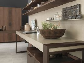 8. This new style proposes to evolve the minimalism: from the contact to object intended as simplicity and clearness of shapes to the recovery of rationalism and functionality, tied to the real qualities and to the materials that characterise the kitchen. (2/3)