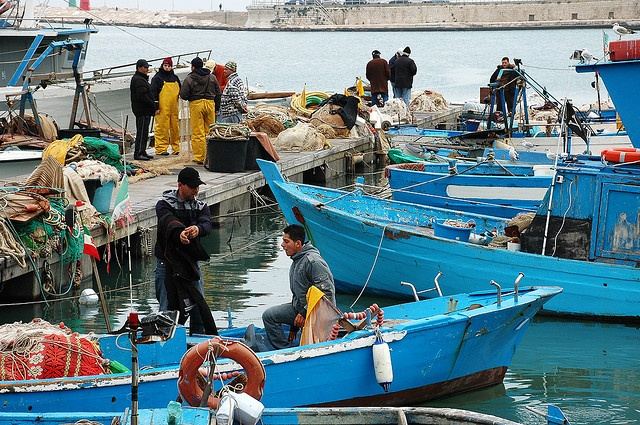 Trani, Puglia - Fishermen at harbour by Danielzolli, via Flickr