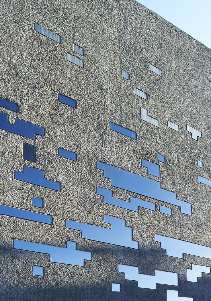 Concrete facade + glass & steel perforations -TEA Tenerife