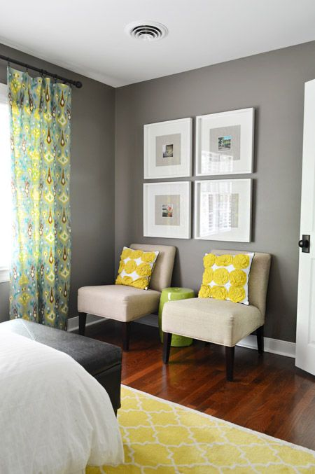 Bird's The Word | Young House Love. paint color is Sparrow by Benjamin Moore. love the photo arrangement over the chairs.