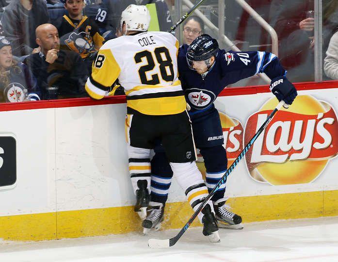 Jets vs. Penguins - 03/08/2017 - Pittsburgh Penguins - Photos  Ian Cole #28 of the Pittsburgh Penguins checks Joel Armia #40