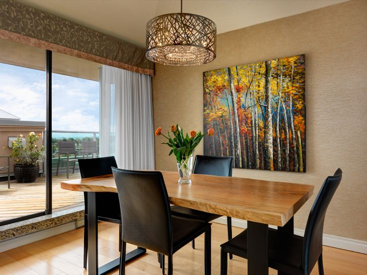 Dining area of the One Bedroom Penthouse, with access to the wrap around deck and panoramic views of the inner harbour and Juan de Fuca Strait.