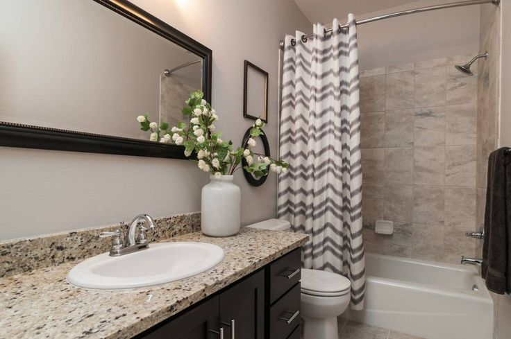 Guest Bathroom Main Level With Espresso Cabinets And Crema