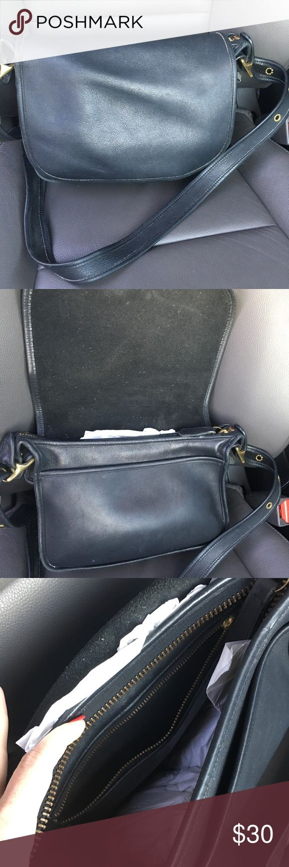 Black Coach Purse Good used condition Black Coach Purse. Shows normal wear. No huge marks or obvious visual flaws. Zipper works great. Recently cleaned at leather shop. Coach Bags