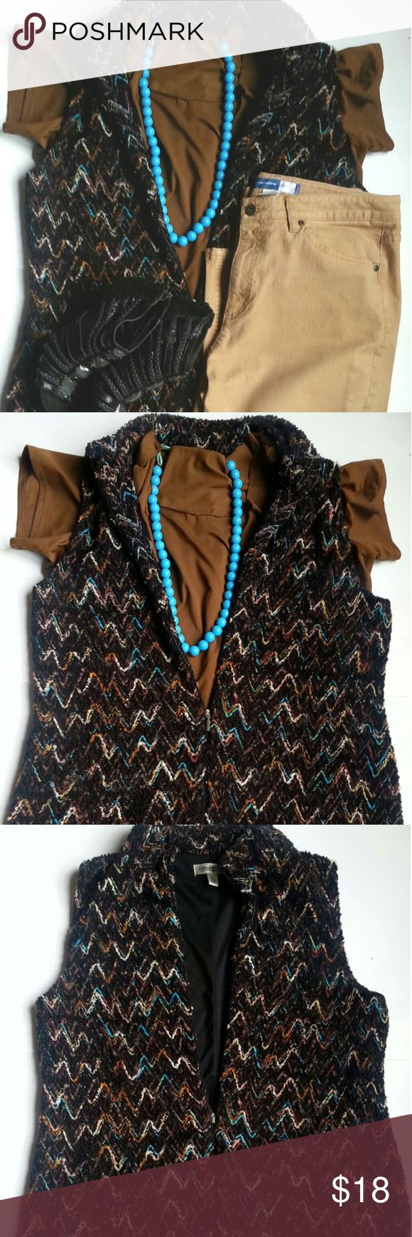 XL Coldwater Creek vest. This is 60% polyester vest has great texture. The shades of tan, brown, light blue, pink and green zigzag lines creates a stylishvpiece of wearable art. Coldwater Creek Jackets & Coats Vests