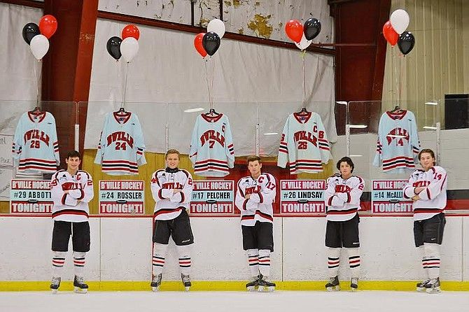 Baldwinsville ice hockey seniors (from left) Matt Abbott, Andy Rossler, James Pelcher, Kyle Lindsay and Charlie McAllister were honored prior to Friday night's game against Cicero-North Syracuse. Abbott, Lindsay and Pelcher each would have a goal in the Bees' 10-1 victory over the Northstars.