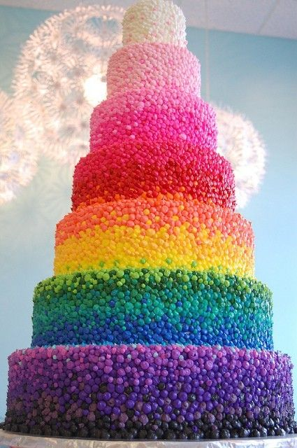 Incredible rainbow wedding cake, crafted with thousands of tiny frosting dots. Check out the gradient, very impressive!