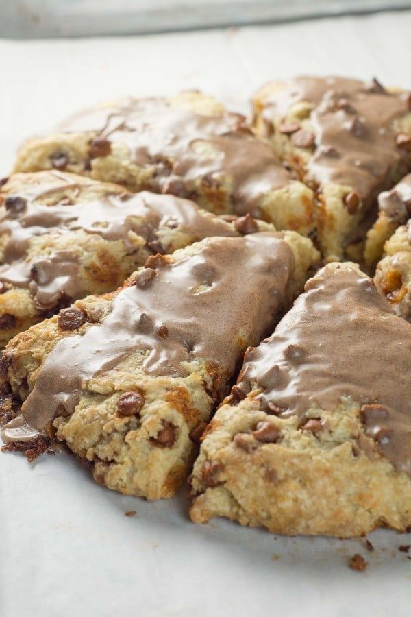 Easier than cinnamon rolls, cinnamon chip scones go together quickly. Full of cinnamon chips, topped with a sweet glaze & are begging for a cup of coffee.