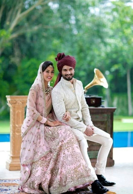 Coordinated outfits, Tips for Couple outfits | Bride Meera ragout wears a pink lehenga and groom shahid Kapoor wearing a deep Burgundy matching saafa| The ultimate guide for the Indian Bride to plan her dream wedding. Witty Vows shares things no one tells brides, covers real weddings, ideas, inspirations, design trends and the right vendors, candid photographers etc.| #bridsmaids #inspiration #IndianWedding | Curated by #WittyVows - Things no one tells Brides | www.wittyvows.com