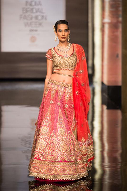 Pink and gold paneled Indian bridal lehnga by JJ Valaya at India Bridal Fashion Week. More here: http://www.indianweddingsite.com/bmw-india-bridal-fashion-week-ibfw-2014-jj-valaya/