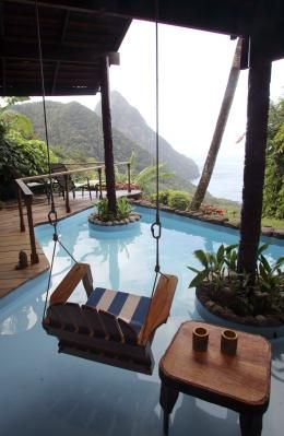 Perched high on the volcanic Caribbean island, this room at Ladera in St. Lucia has only three walls; a steep cliff above a green jungle is where the fourth wall would be. Photo: Michael Goulding, Orange County Register / HC