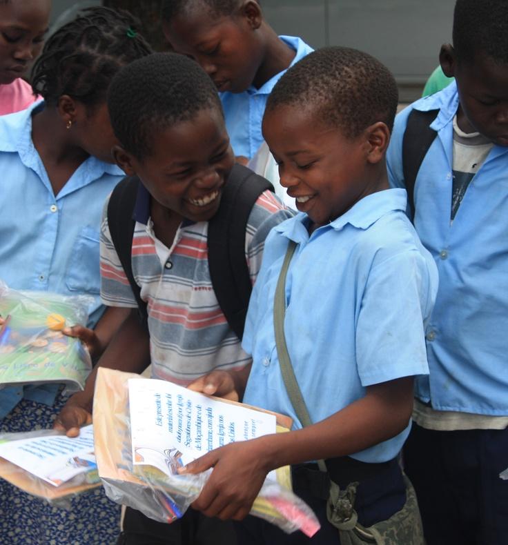 Handing out school supplies to needy children.