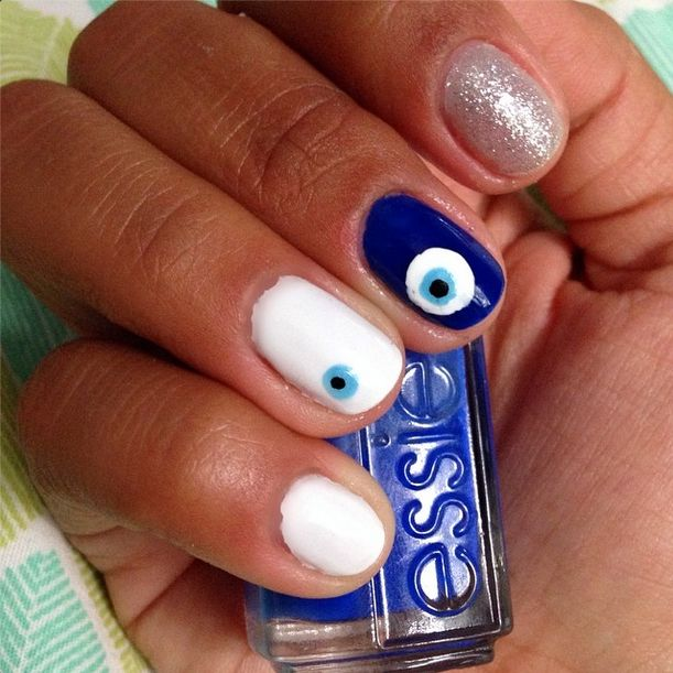Gorgeous evil eye nail art that will ward off the bad guys.