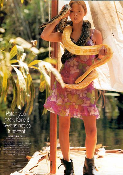 love those boots with floral skirt and boa snake also