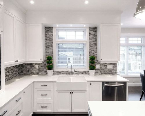 Prefab cabinets.  Not a fan of the cool colors at the backsplash.  Better to enhance warmth.
