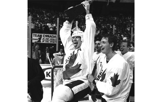 Wayne Gretzky (R) skates around the ice with Mark Messier (L), who holds the trophy as they celebrate Canada's victory in the 1987 Canada Cup hockey tournament in Hamilton September 15, 1987. The tournament, started in 1976, saw the Soviets beat Canada for the championship in 1981. Canada returned the favour in 1987.