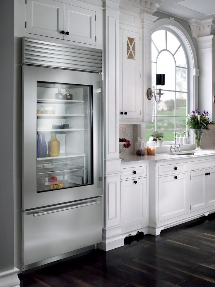 Built-in Sub-Zero with see-through door.      No more opening your refrigerator door to see what there might be to eat.